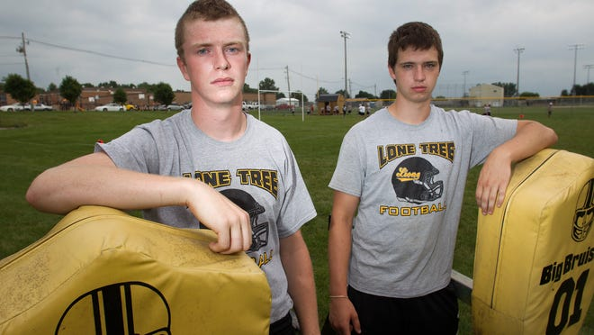 Lone Tree's Travis Gillham, left, and Matt Wieland pose at their school's practice field Friday in Lone Tree. City-Press Citizen