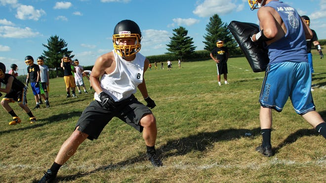 Mid-Prairie players practice Aug. 12 at their school's practice field in Wellman. The biggest questions are on offense where the Golden Hawks must replace 10 starters including their quarterback, entire offensive line, top rusher and top five receivers from last season.
