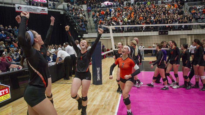 Solon players celebrate their Class 3A semifinal win over Nevada at the U.S. Cellular Center in Cedar Rapids on Thursday. Solon's 25-20, 25-13, 25-21 win propelled the Spartans to the title game for the third consecutive year.