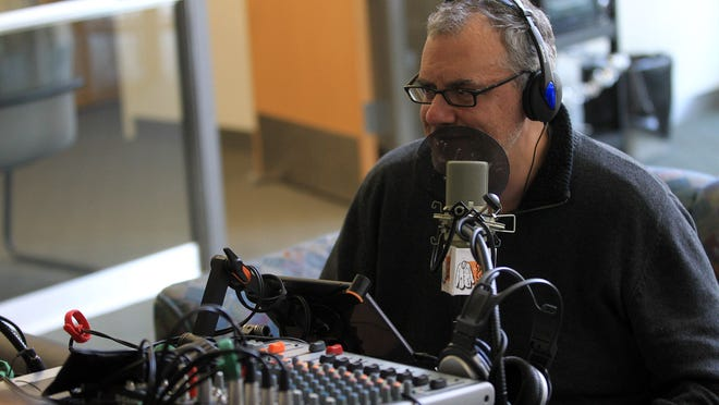 """Dave Etler hosts a Dec. 19 episode of """"The Short Coat Podcast"""" at the University of Iowa Medical Education and Research Facility."""