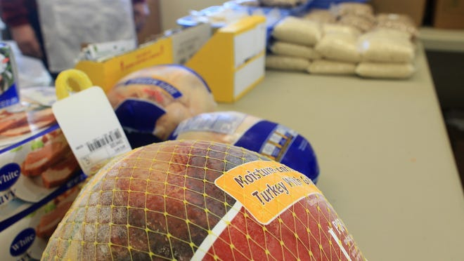 Turkey and other holiday foods are seen during Project Holiday at the North Liberty Community Pantry on Wednesday, Dec. 17, 2014.