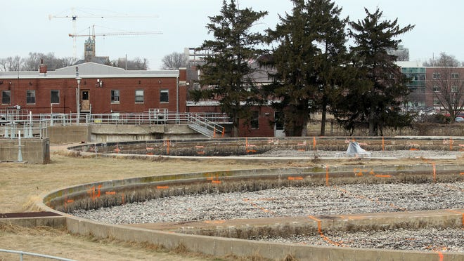 Work is underway at the decommissioned wastewater treatment plant along the Iowa River, where the city plans to tear down the old flood-prone facility, once a current mercury abatement project is complete, to make room for the new riverfront park.