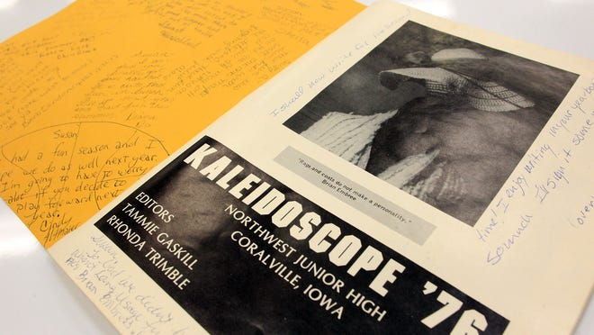 A 1976 Northwest Junior High yearbook is seen in the newly-renovated library on Friday, Feb. 6, 2015. The yearbook was found above a false ceiling by an electrician working on wiring. The school was founded in 1972.