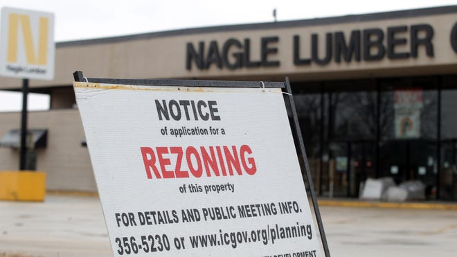 A rezoning notice is seen in front of Nagle Lumber on Tuesday, March 24, 2015.