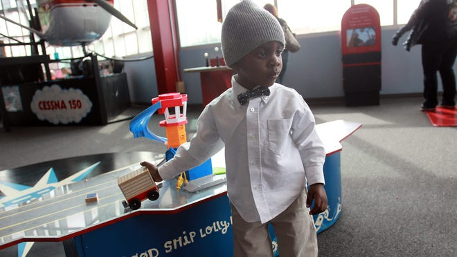 Two-year-old Amaren Shaw explores the Iowa Children's Museum in Coralville on Wednesday, April 1, 2015. Shaw was diagnosed with autism in November and receives multiple types of therapies to help him. David Scrivner / Iowa City Press-Citizen