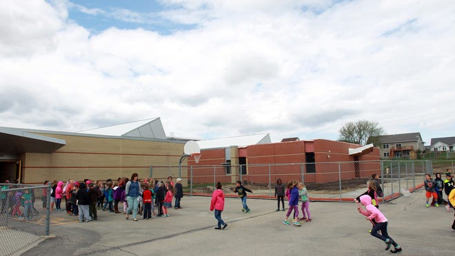 The exterior of one side of the building addition is seen as students enjoy recess Tuesday at Van Allen Elementary in North Liberty.