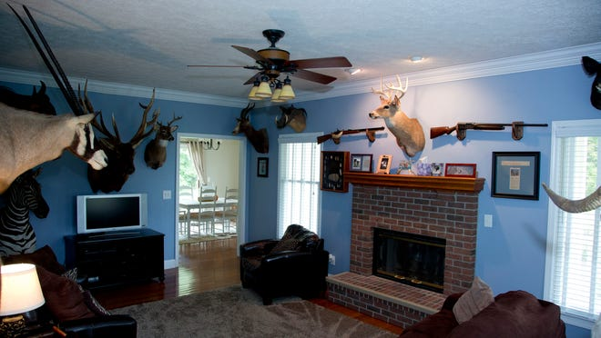 Jim Roszell decorated his man cave with a hunting theme.