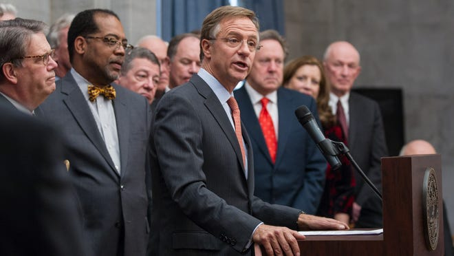 Gov. Bill Haslam announces his proposal to expand Medicaid in Tennessee during a December news conference at the state Capitol in Nashville. The governor called the state legislature into a special session that began Monday to take up the proposal, which would make Tennessee the 28th state plus Washington, D.C., to expand Medicaid under the Affordable Care Act.