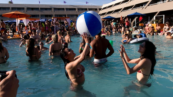 Electronic dance music fans dance as Moby performs at Splash House Palm Springs Pool Festival held in June at Hard Rock Hotel Palm Springs.