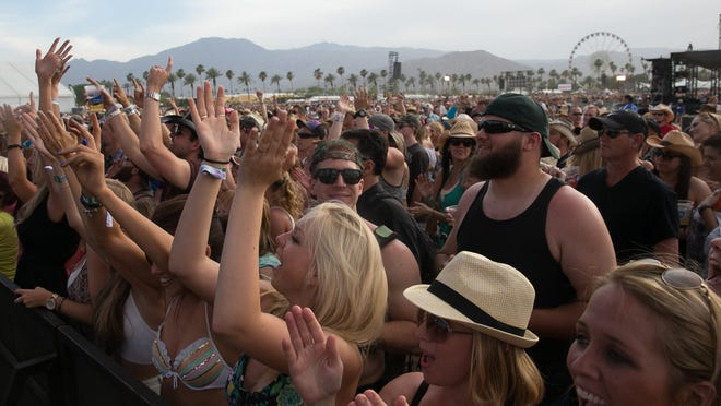 Country music fans react at the Mane stage during last year's Stagecoach music festival.