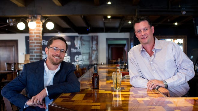 Restaurant owners Dan Postal (left) and Jason Ford are having success with their Kelly's at SouthBridge in downtown Scottsdale.