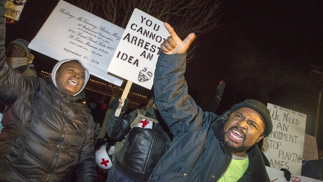 Protester Rob Hamilton and others demonstrate outside the Ferguson Police Station this week.