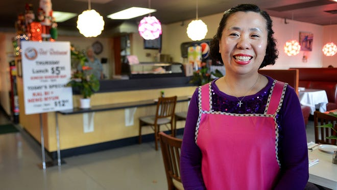 Hillary Park, the owner of Bibimbap House, a Korean restaurant, on Chemeketa Street in downtown Salem on Thursday, Dec. 11, 2014.