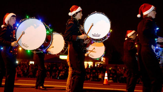The Sprague High School marching band performs during the Keizer Festival of Lights Parade on Saturday, Dec. 13, 2014.