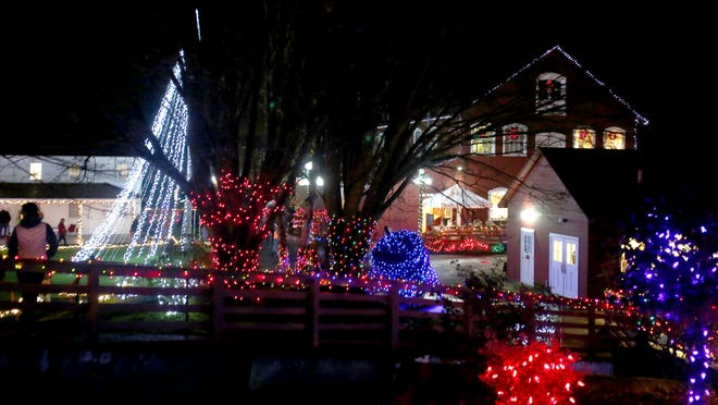 Colorful lights fill the pathways during the 15th annual Magic at the Mill in Salem on Sunday, Dec. 21, 2014.