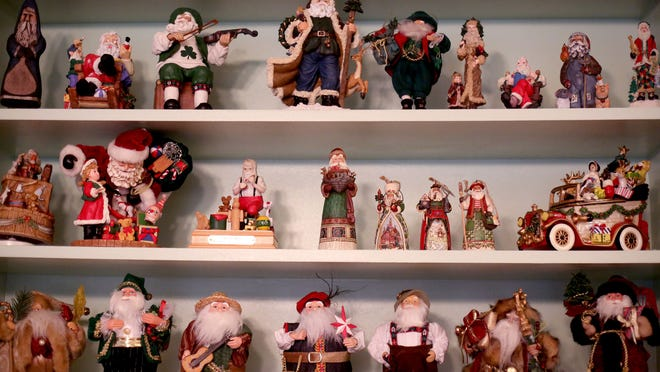 Some of the more than 300 pieces in the Santa Claus collection of Dennis and Barbara Rice in Keizer on Wednesday, Dec. 17, 2014.