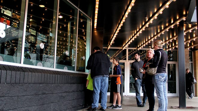Moviegoers line up for tickets at the Cinebarre movie theater in downtown Salem on Thursday, Dec. 25, 2014.