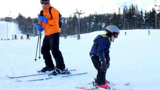 Nathan Hardy, of Everett, Wash., and his son Ethan Hardy, 6, ski together at Mount Hood Meadows on Friday, Dec. 26, 2014. They were in the Portland area visiting family for the holidays and took the trip to Mt. Hood so Ethan could ski for the first time.