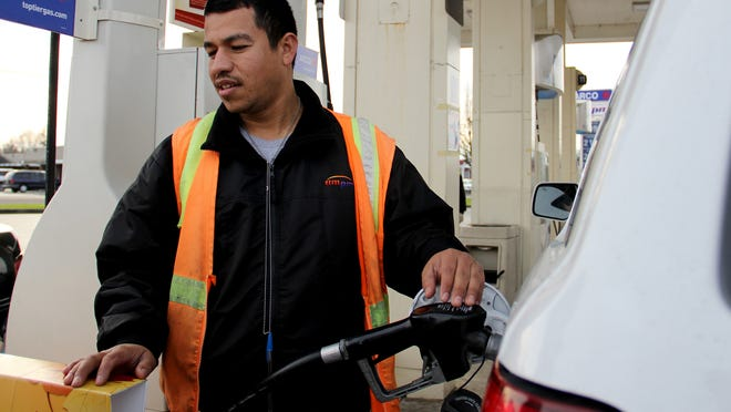 Paul Mejia pumps gas at the ARCO gas station on Market St. NE and Lansing Avenue in Salem on Wednesday, Jan. 14, 2015. Gas was 1.99 at the station on Wednesday afternoon.