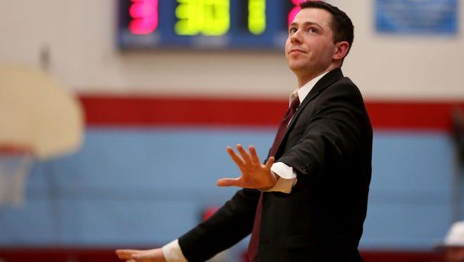 North Salem head coach Jordan Graneto watches the clock in the first half.