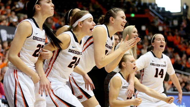 Oregon State players celebrate a three-pointer in the second half of the USC vs. Oregon State women's basketball game in Corvallis on Saturday. The Beavers won the game 68-35.