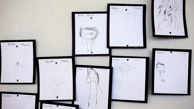 Self-portraits drawn by students in September and January are on display in a Bethel Head Start classroom Wednesday, Feb. 4.