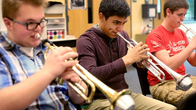 West Salem senior David Hendrick (from left) and juniors Octavio Jimenez and Max Jones rehearse for the High School All City Honors Concert. The concert will feature Salem-Keizer's best high school musicians in a combined band, choir and orchestra concert at 7 p.m. Saturday, Feb. 21, at North Salem High School.