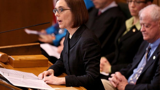 Kate Brown addresses the legislature and public after being sworn in as the 38th Oregon governor at Oregon State Capitol in Salem on Wednesday.