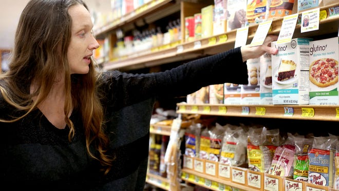 Jazzminh Moore, 36, of Salem, shops for non-GMO foods Thursday, Feb. 12, at LifeSource Natural Foods in Salem.