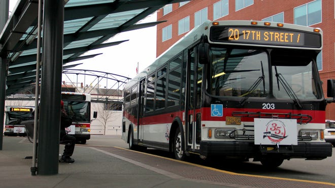 Cherriots buses stop at the main station in downtown Salem on Friday, March 13, 2015.