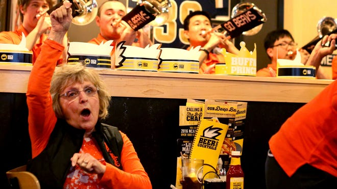 Judy Rinkin, of Albany, cheers for the Beavers during the NCAA Selection Show watch party for the Oregon State women's basketball team Monday, March 16, at Buffalo Wild Wings in Corvallis.