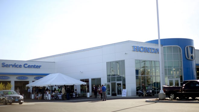 A grand opening ceremony of the Lithia Motors Inc., car dealerships on Salem Parkway in Salem on Wednesday, March 18, 2015.