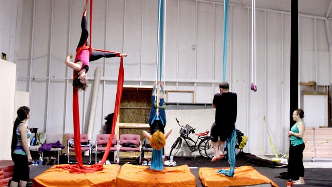 An aerial fitness class is held at Club Defy, in the same building as Parkour Infinity.
