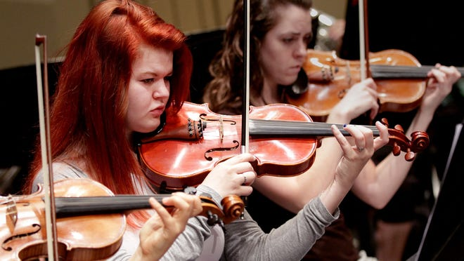 McKay junior Chelsea Dennis plays violin during a rehearsal for the Salem Youth Symphony at North Salem High School. The Youth Symphony's 60th anniversary concert will be at 3 p.m. May 3 in Smith Auditorium at Willamette University.