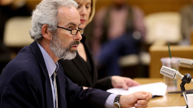 Sen. Floyd Prozanski speaks during a meeting of the House Committee on Rules on Senate Bill 941, which would require background checks for private gun sales and transfers, at the Oregon State Capitol in Salem on Wednesday, April 22, 2015.