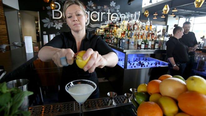 Tara Bidwell makes a lemon drop in Gustav's Bargarten at Keizer Station on Thursday, April 23, 2015, in Salem, Ore.