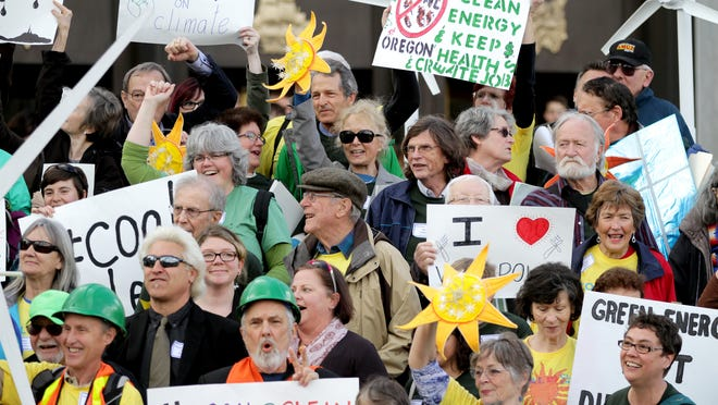 People gather on the steps of the Oregon State Capitol during a Coal to Clean Energy rally in Salem on Tuesday, March 24.