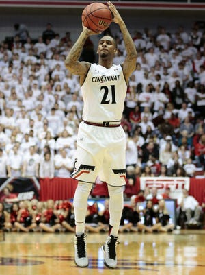 Cincinnati Bearcats guard Farad Cobb (21) shoots from 3-point range in the first half of the NCAA basketball game between the Cincinnati Bearcats and the Connecticut Huskies at Fifth Third Arena on the campus of the University of Cincinnati in Cincinnati on Saturday, Feb. 20, 2016. At the half, the Bearcats led 29-24.