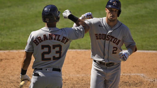 Houston's Alex Bregman is congratulated by Michael Brantley after hitting a solo homer in the seventh inning Sunday.