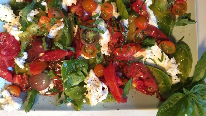 Make a great caprese with heirloom tomatoes, mozzarella and fresh basil.