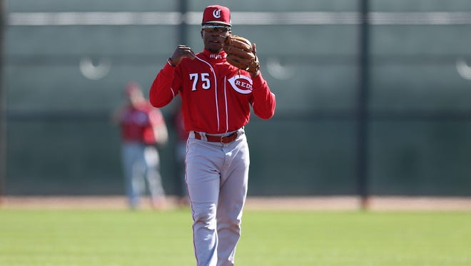 Cincinnati Reds second baseman Shed Long (75) gets set for groundball drills, Tuesday, Feb. 20, 2018, at the Cincinnati Reds Spring Training facility in Goodyear, Arizona.