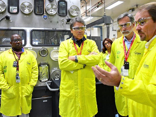 U.S. Energy Secretary Rick Perry, second from left, is facing a call to resign after his department acknowledged mistakes with low-level radioactive waste shipments.