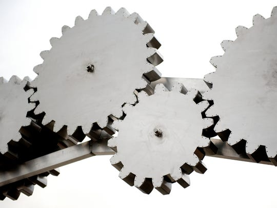 A detailed look at the large gears of a new sculpture