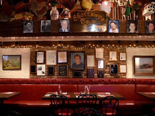 Many family portraits hang on the walls of Shortway's Barn.