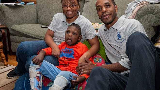 Felicia Y.R. Baker, left, and her husband, Brian Baker, with their son, Eli, 5, have started a home care agency called E.L.I. (Excel Living Independent) in the wake of the struggles with Eli, who has special health needs. (Photo by Keith A. Muccilli/ Special to NJ Press Media)