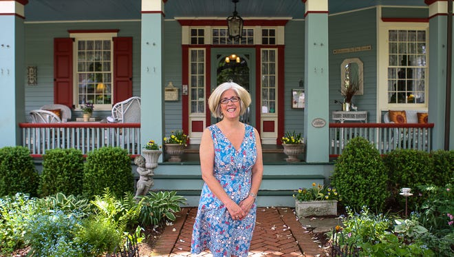 Donna Arold, who, with husband Ken Arold, owns Main Street Manor Bed & Breakfast in Flemington, in front of the business.