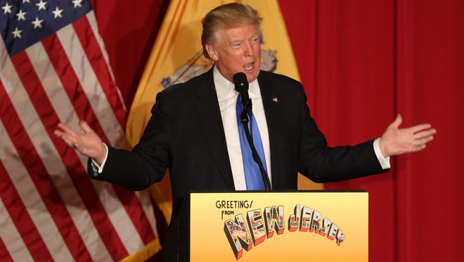 Donald Trump holds a rally at the National Guard Armory in Lawrence. The event served as a fundraiser for Gov. Chris Christie.