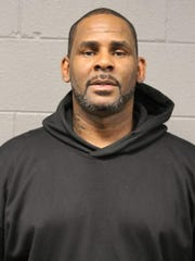 R&B singer R. Kelly is photographed during booking Friday, Feb. 22, 2019, at a police station in Chicago.