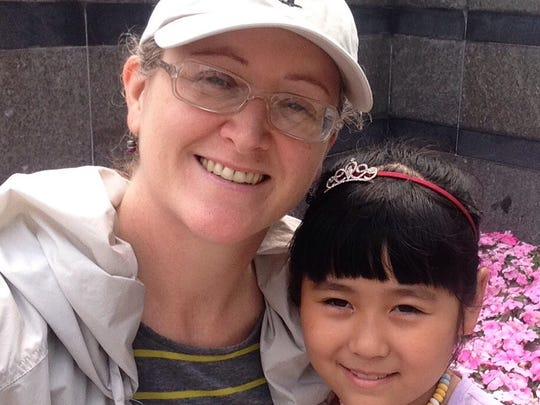 Julie Tovey takes a selfie with one of her English immersion students, Joy.