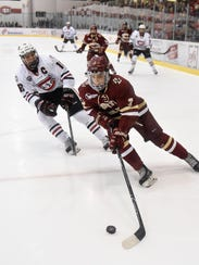 Judd Peterson of St. Cloud State chases Luke McInnis